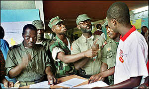 Soldiers at a counting station joke with an electoral official