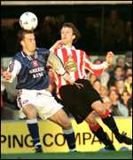 [ image: Mark Venus heads away from Nicky Summerbee]