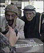 Palestinians playing dominoes
