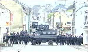 Armoured vehicle and row of police