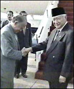 [ image: Officials bid President Suharto (right) bon voyage]