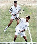 Arvind Parmer (front) and Tim Henman playing Ecuador in the Davis Cup