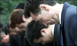 Mourners outside Imperial Palace