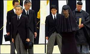 Japanese Emperor Akihito [L] and Empress Michiko at the funeral hall