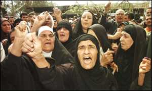 Iraqi mothers crying in front of UN building in Iraq