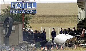 Hotel sign with plane's wreckage