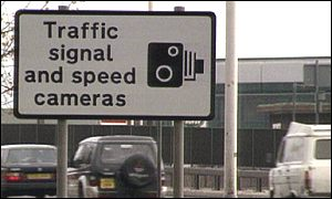 Speed camera warning sign