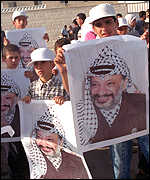 Palestinians with posters of Arafat
