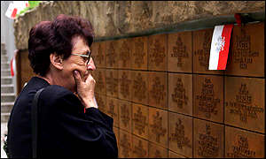 Man looks at the names of the dead officers