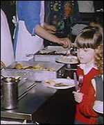 Child receiving school dinner