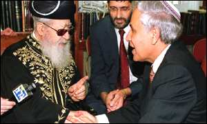 Moshe Katsav is greeted by Shas spiritual leader Rabbi Ovadia Yosef