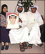 Hannan al Dowkhi with her brothers, Adal, Fawzi and Hani, holding a picture of their missing brother Salah