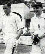 Colin Cowdrey walking out to bat with Peter May