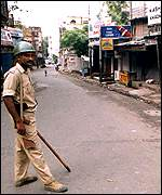 A soldier patrols the deserted streets of Jammu