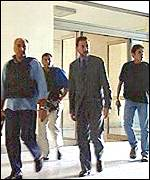 Cataldo Motta (centre) is always accompanied by armed guards