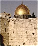 The Western or Wailing Wall, and in the background the Dome of the Rock