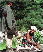 Indian soldier talks to a Hindu holy man