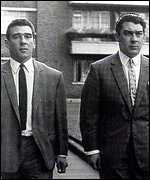 The Krays wearing smart suits