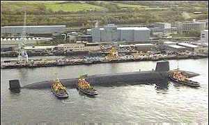 Sub and tugs at Faslane
