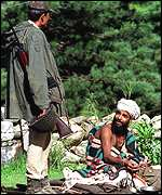 Securityman talking to a pilgrim in Pahalgam