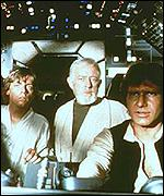 Mark Hamill, Sir Alec Guinness and Harrison Ford in Star Wars