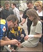 An injured woman receives treatment