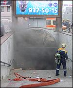 Smoke pours from the subway