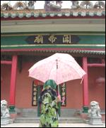 Malay woman outside a Chinese temple