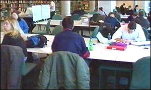 students working in university library