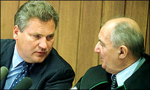 Polish President Aleksander Kwasniewski, left, talks to his lawyer Czeslaw Jaworski during the hearing