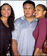 Muhammad Ali with daughters May May and Hanna