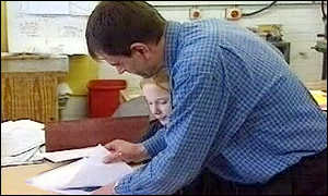 teacher helping pupil