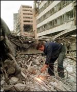 Worker removing bomb damage in Serbia