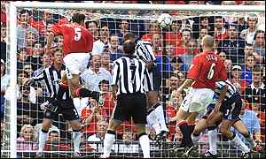 Ronny Johnsen heads home United's opening goal