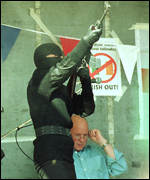 John White sitting behind loyalist firing shots
