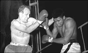 Henry Cooper in action