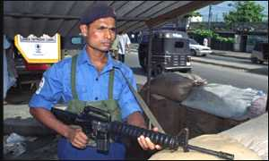An armed soldier stands guard in Colombo, Sri Lanka,