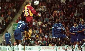 Dean Windass outjumps the Chelsea defence to score Bradford's first