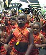 Young children dressed in orange at Carnival