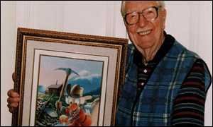 Carl Barks holding his last Uncle Scrooge oil painting called Eureka!