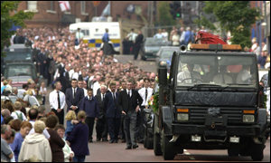 Lorry laiden with floral tributes led cortege