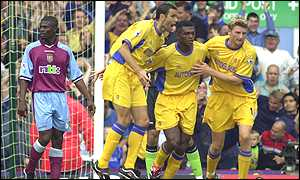 Chelsea players celebrate Marcel Desailly's equaliser
