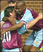 Luc Nilis is mobbed after his spectacular Villa opener