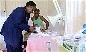 14-year-old Sifiso Nyembe having his wounds tended