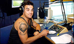 Robbie Williams guest-hosting a show for Capital FM in London