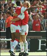 [ image: Anelka (left) and Parlour celebrate]