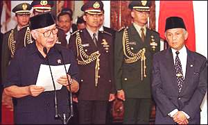 Suharto resigns