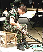 Soldier of the Royal Irish Regiment checking his weapon