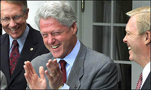 President Clinton laughing at a joke about Bush's gaffe