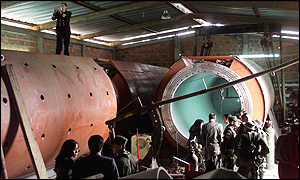 Colombian police and naval officers inspect the half-built sub